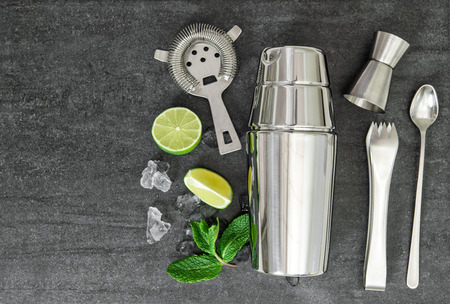 Cocktail shaker and aperitif ingredients. Mojito. Caipirinha