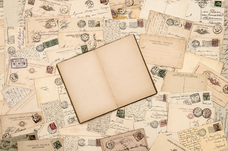 old letter: Vintage paper background. Old handwritten postcards and open empty book