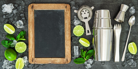 cocktail shaker: Drink making tools and ingredientsLime and mint leaves. Blackboard for recipe