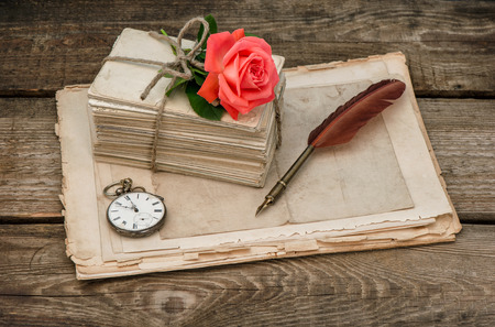 old letters: Old love letters and red rose flower. Vintage sentimental background Stock Photo