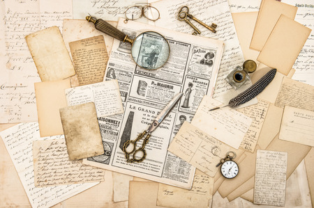ephemera: Antique office accessories, old letters and postcards, vintage ink pen. Nostalgic paper background. Ephemera and newspaper Stock Photo