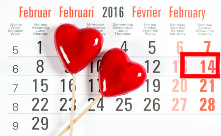 14 february: Calendar with red mark on 14 February. Decoration red hearts. Valentines day