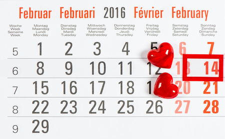 14 of february: Calendar with red mark on 14 February. Red hearts. Valentines day concept Stock Photo