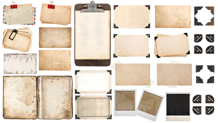 Used paper sheets, book, old photo frames and corners, antique clipboard. Vintage office objects isolated on white background. Stockfoto