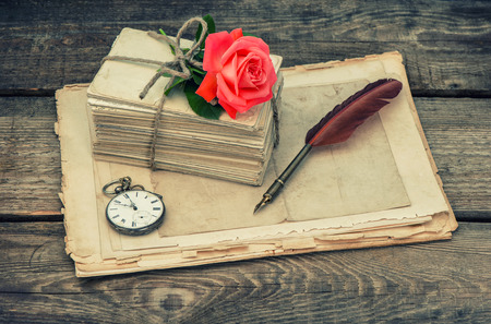 pocketwatch: Love letters and pink rose flower. Vintage style toned picture