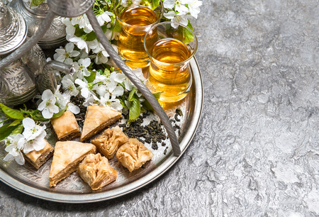 baklawa: Tea glasses and pot, traditional sweets. Islamic holidays decoration