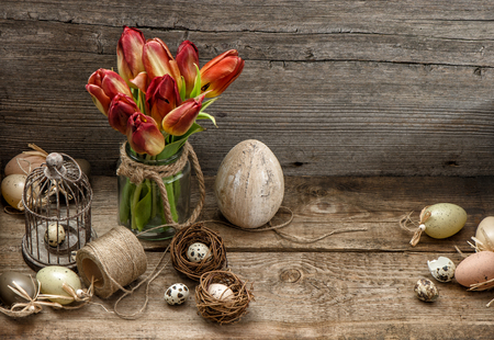 country style: Easter decoration with eggs and tulip flowers. Country style still life