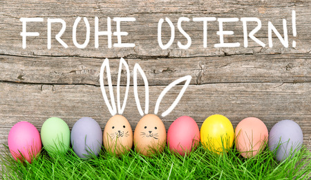 frohe: Easter eggs cute bunny. Funny holidays decoration. German text Frohe Ostern Happy Easter! Stock Photo