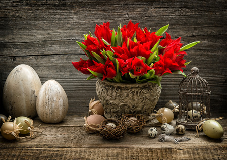 red tulip: Red tulips and Easter eggs. Vintage decoration with spring flowers. Dark toned picture