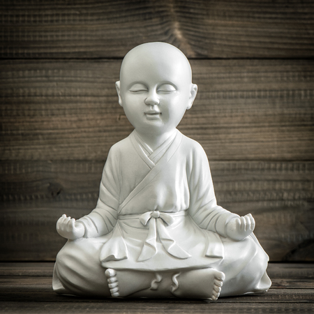 buddha statue: Sitting buddha. Meditation and relaxing concept. Vintage style toned picture