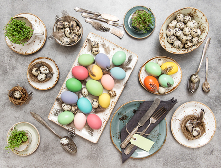 a place of life: Easter still life. Festive table place setting with colored eggs