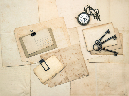 sentimental: Vintage accessories, old postcards and papers. Sentimental nostalgic background Stock Photo