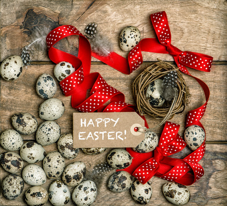 red ribbon bow: Easter eggs with red ribbon bow and paper tag. Happy Easter!