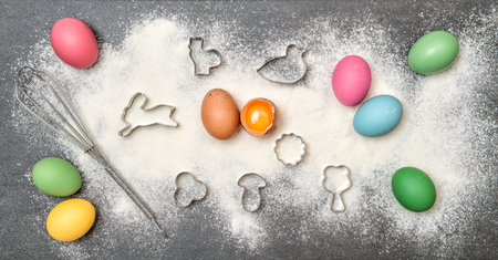 cakes background: Easter food background. Cookies ingredient and colored eggs Stock Photo