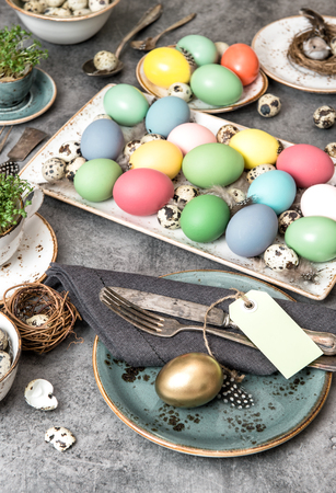 place setting: Easter decoration. Festive table place setting. Vintage style home interior Stock Photo