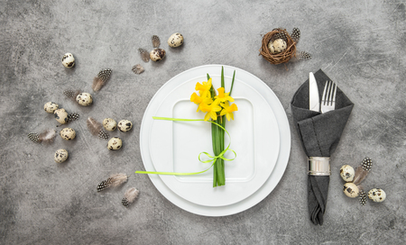 a place of life: Easter still life. Festive table place setting decoration with eggs and flowers. Top view