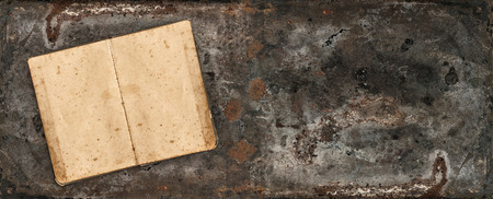 table surface: Antique book on rustic metal table surface. Vintage style background Stock Photo