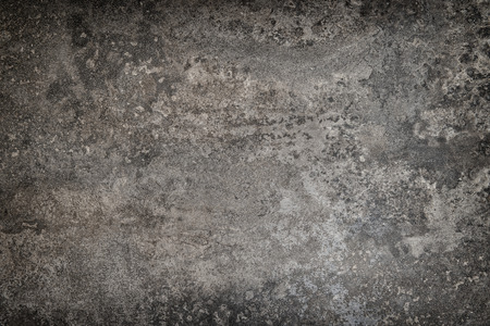 table surface: Rustic stone table surface. Vintage style background. Dark toned picture