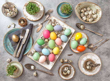 Easter decoration. Festive table setting with colored eggs