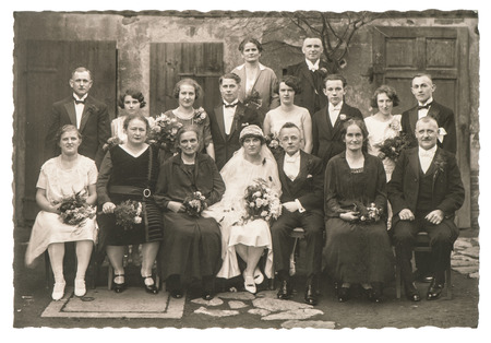 young to old: BERLIN, GERMANY - CIRCA 1936: Old family wedding photo. People wearing vintage clothing. Antique fashion dress Stock Photo