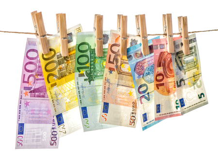 Money background. Euro banknotes hanging a rope with clothes pins. Selective focus 스톡 콘텐츠