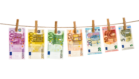 Euro banknotes hanging a rope with clothes pins. Money background. Money laundering concept
