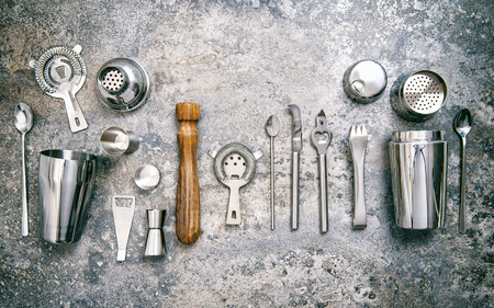 Bar tools for making cocktail. Shaker, jigger, strainer, spoon. Food and beverages. Vintage style toned picture 스톡 콘텐츠
