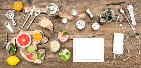 cocktail strainer: Food blogger desk with bar tools, accessories and electronic devices. Flat lay background