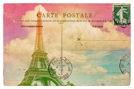 Vintage styled french postcard Eiffel Tower Paris. Retro toned paper background