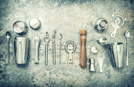 bar tool set: Bar accessories and utensils for making cocktail. Shaker, jigger, strainer, spoon. Vintage style toned picture Stock Photo