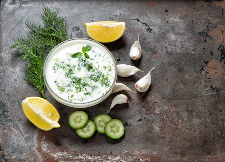 Tzatziki sauce. Fresh dip with herbs dill and mint. Food background Standard-Bild