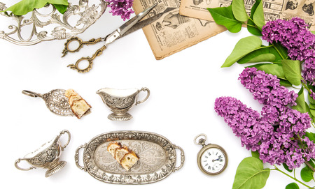 antique dishes: Lilac flowers, antique silver dishes. Vintage objects. Flat lay