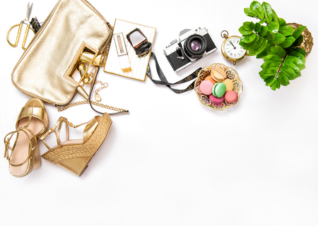 bloggers: Flat lay for social media fashion bloggers. Feminine accessories, bag, shoes, vintage no name photo camera on white background