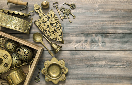 grunge silverware: Vintage brass table ware. Kitchen table with antique tools and utensils