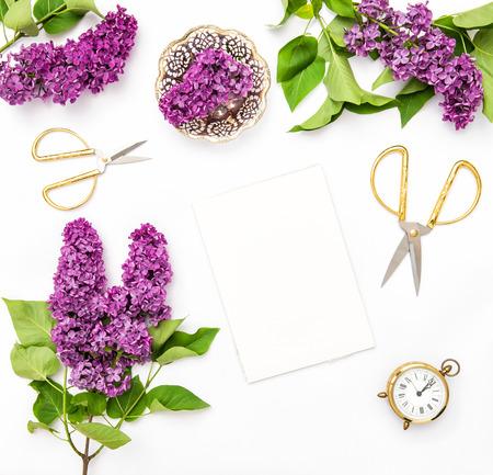 sketchbook: Lilac flowers, sketchbook, office supplies. Flat lay background top view