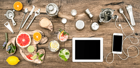 Kitchen table with bar tools, accessories and electronic devices. Flat lay background Archivio Fotografico