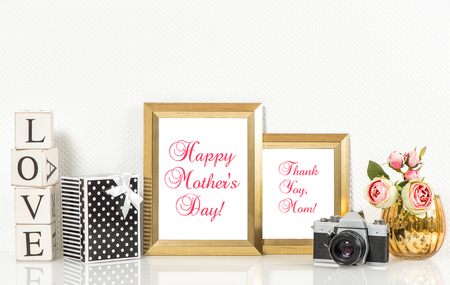no name: Golden picture frames, roses flowers and no name vintage camera. Copy space for Your designs. Happy Mothers Day Stock Photo