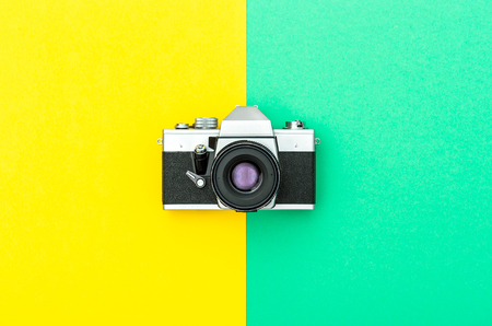 Vintage camera on color hipster background. Instagram style toned picture. Minimal concept