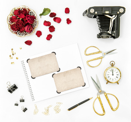 retro flowers: Flat lay background with red roses flowers, vintage camera and photo frames Stock Photo