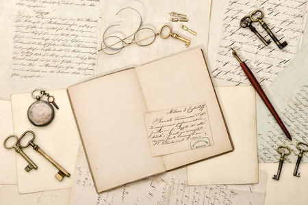 old letters: Open book, old letters, antique accessories. Nostalgic vintage style background