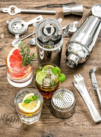 martini shaker: Cocktails with fruits and ice. Cold lemonade, mojito, caipirinha. Bar drink making tools Stock Photo