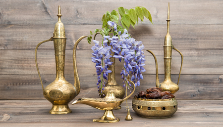 holy jug: Vintage arabic jug, vase, lamp, tea pot. Fruits and flowers. Golden oriental decorations Stock Photo