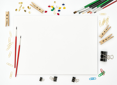 flat brushes: Sketchbook, brushes, paper, office supplies on white background. Flat lay. Creative art concept Stock Photo