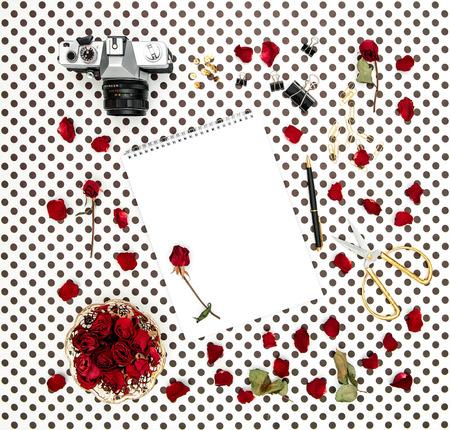 sketchbook: Flat lay with sketchbook, red roses, vintage camera, scissors on polka dot background Stock Photo
