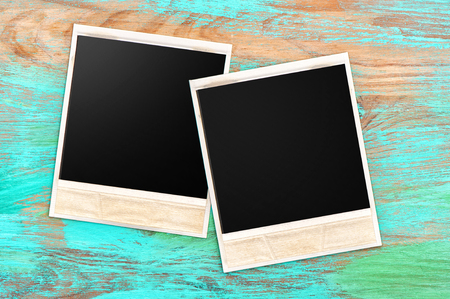 texture backgrounds: Retro style photo frames on rustic blue wooden background