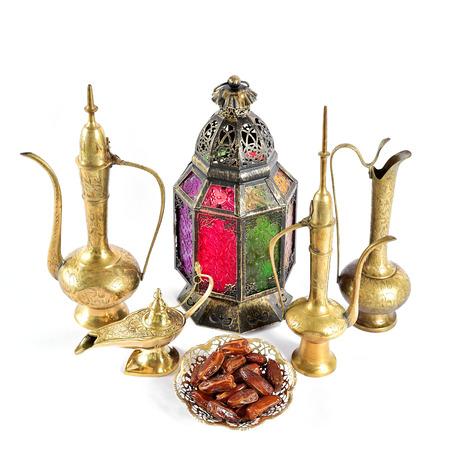 Oriental holidays decoration lantern, pots, dishes. Islamic hospitality concept. Ramadan kareem Stock Photo