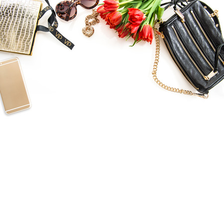 Fashion still life with accessories, flowers, phone on white background