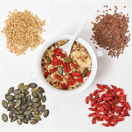 Oatmeal with goji berries, linseed, pumpkinseed. Muesli breakfast.