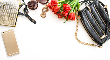 stock photo   tulip: Fashion flat lay with accessories, flowers, phone. Feminine objects on white background