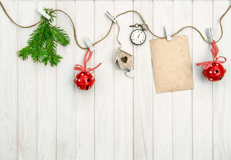 Christmas arrangement with greeting card. Christmas tree branches on bright wooden background Stock Photo